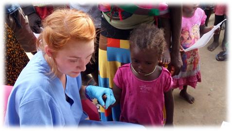 Mission of Hope nurse testing children for malaria